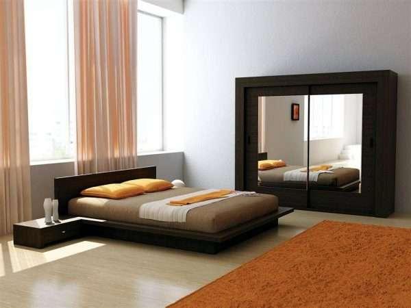 Кровать в стиле минимализм в спальне