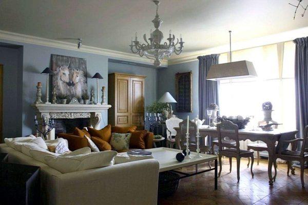Зонирование гостиной-столовой с помощью освещения