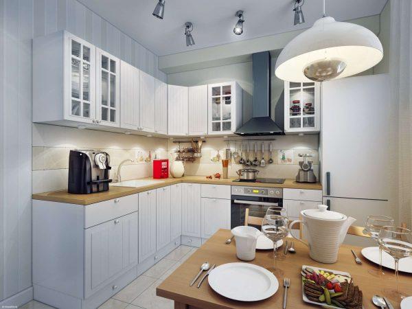 Гостиная совмещенная с кухней с освещением над обеденной зоной