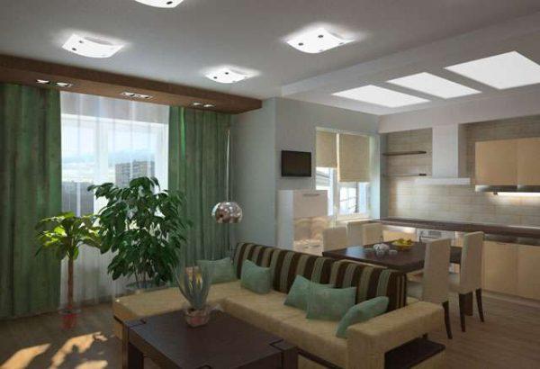 дизайн гостиной совмещённой с кухней с зелёными шторами