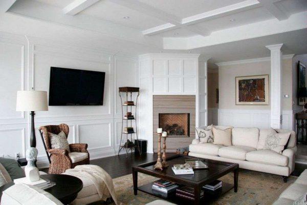 телевизор в интерьере гостиной на белой стене