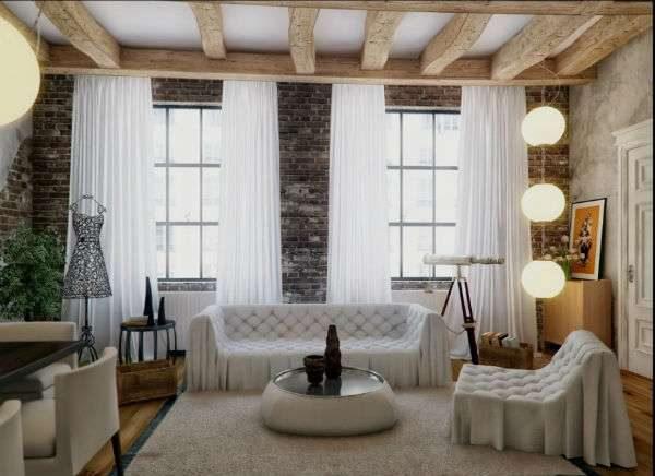 просторная гостиная с двумя окнами и белой мебелью