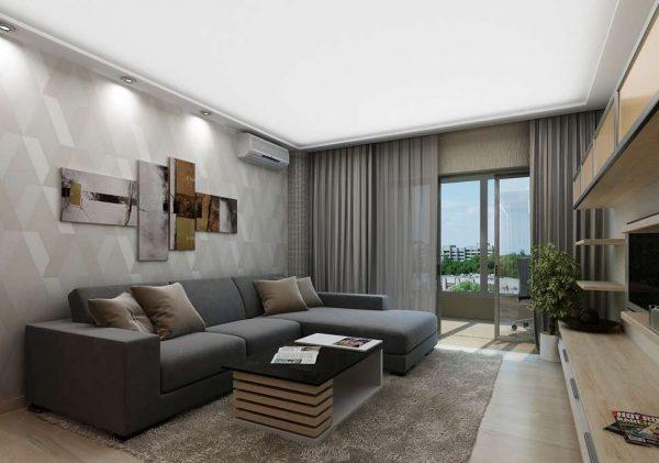 серый угловой диван лаконичного дизайна в интерьере гостиной