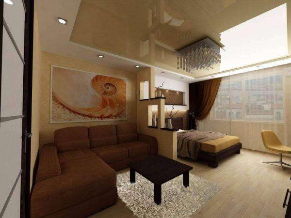 коричневый угловой диван в интерьере гостиной спальни 18 кв. метров