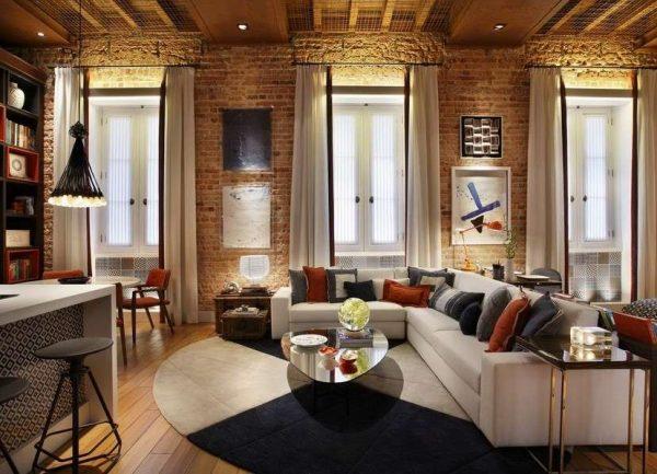 интерьер гостиной в стиле лофт белый угловой диван