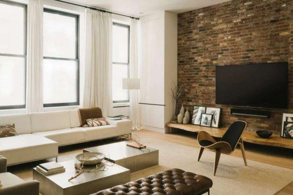 кирпичная стена в интерьере гостиной в стиле лофт