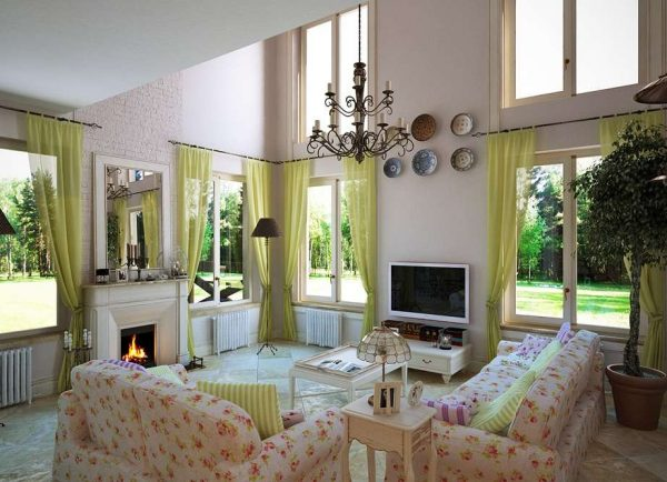 в интерьере светлой гостиной диванная группа пёстрой расцветки