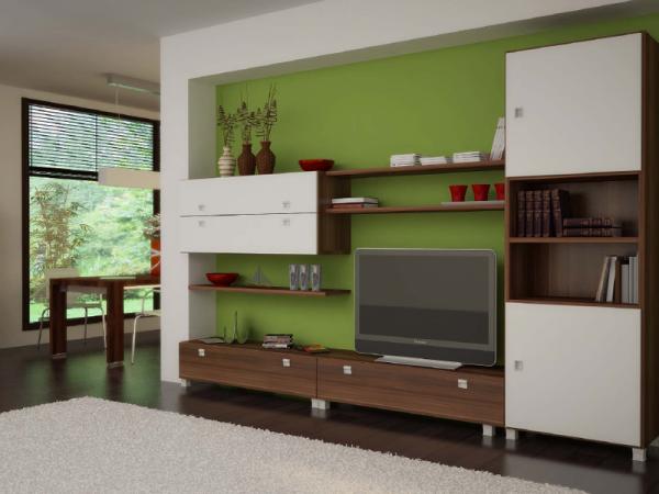 корпусная белая мебель в интерьере гостиной с зелёными стенами