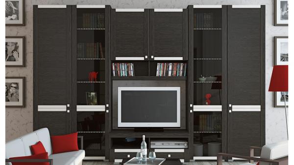 чёрная корпусная мебель в интерьере гостиной с телевизором