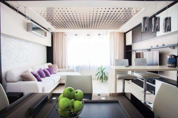 угловой персиковый диван в интерьере небольшой кухни гостиной