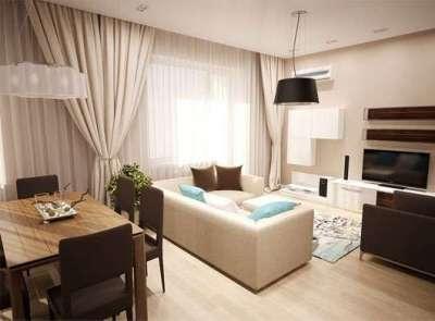 персиковый диван в интерьере кухни гостиной