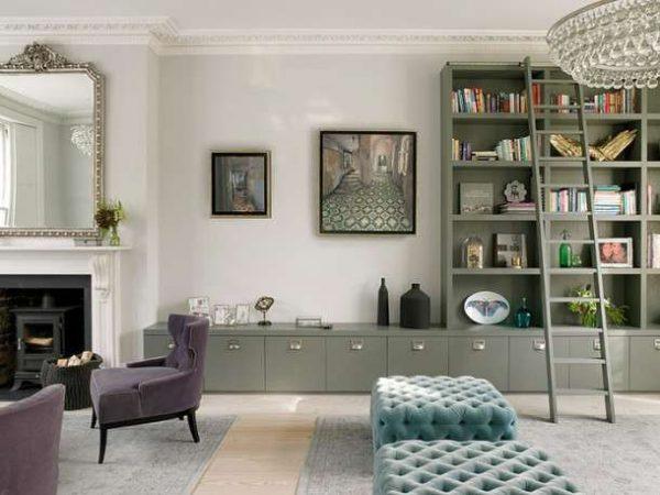 серая современная модульная стенка в интерьере гостиной с камином