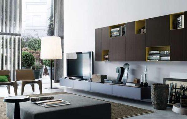 современная модульная стенка с нишами оливкового цвета в интерьере гостиной