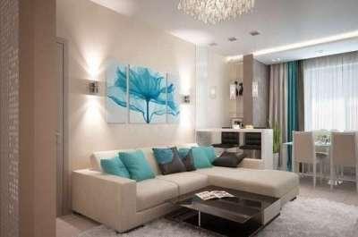 голубая модульная картина с цветком в интерьере гостиной над диваном