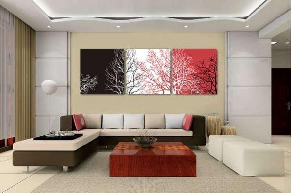модульная картина с абстракцией разных цветов в интерьере гостиной над диваном