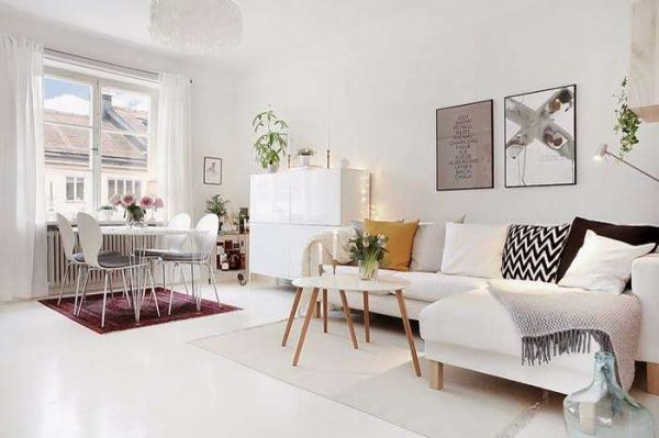 белые полы в интерьере гостиной со скандинавским стилем