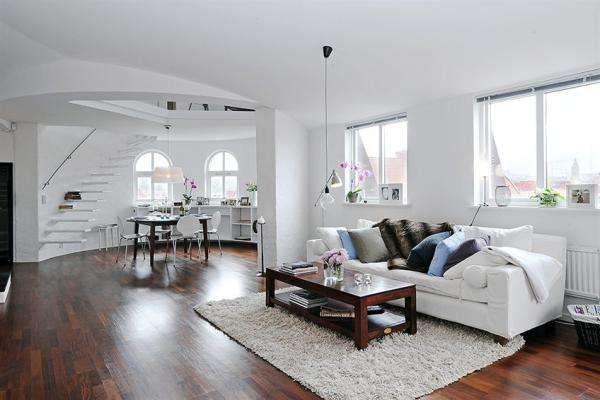 коричневые полы в интерьере гостиной со скандинавским стилем