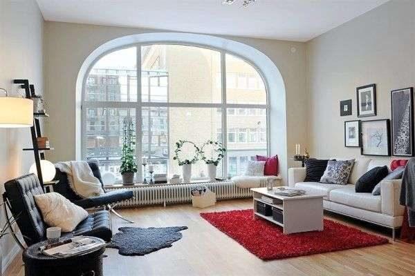 в интерьере гостиной в скандинавском стиле яркий ковёр на полу