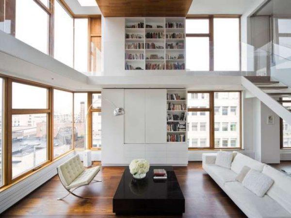 роскошная мебельная стенка в интерьере гостиной на два этажа