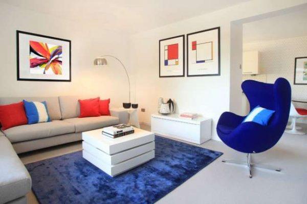 угловой бежевый диван в интерьере гостиной