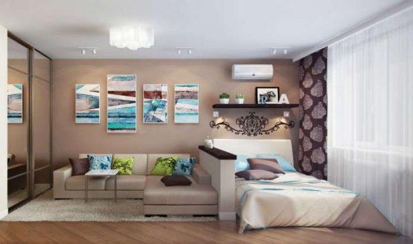 угловой диван в интерьере гостиной, совмещённой со спальней