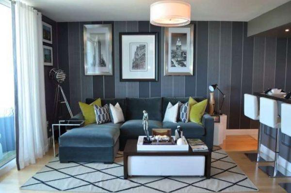 угловой диван в интерьере гостиной в серых тонах