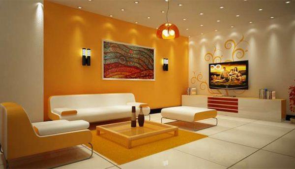 приглушённый жёлтый цвет стен в интерьере гостиной смотрится очень уютно