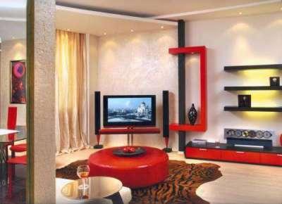 стильная мебель красного цвета в интерьере гостиной