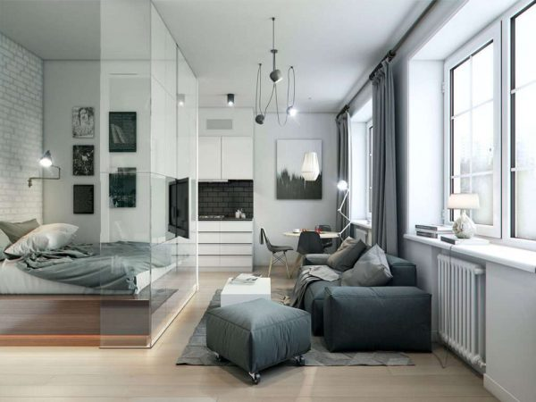 стеклянная перегородка для зонирования в интерьере небольшой гостиной