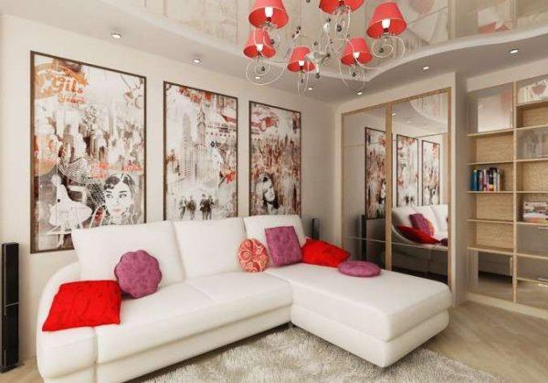 углововй белый диван с яркими подушками в интерьере небольшой гостиной
