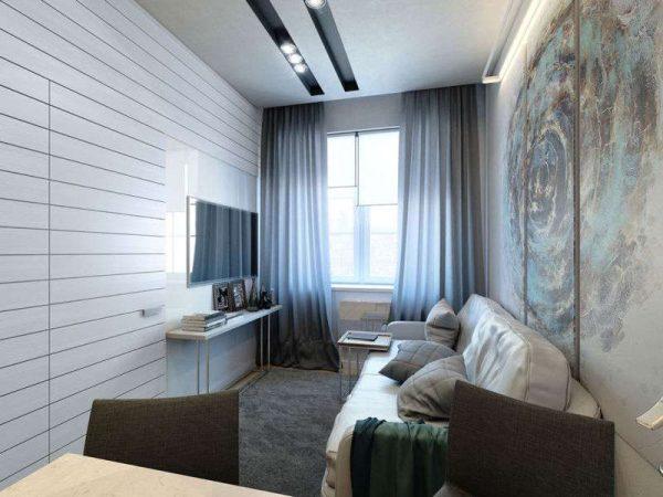 потолочное освещением в интерьере длиной гостиной