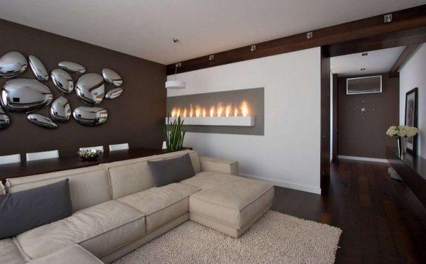 камин в интерьере гостиной в стиле хай тек