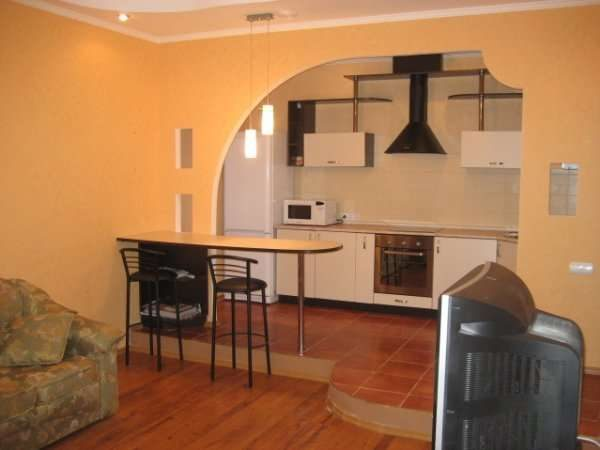 оригинальная арка из гипсокартона на кухне
