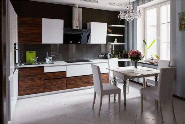 интерьер чёрной кухни с белым обеденным столом