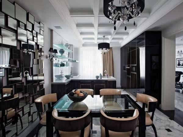 интерьер чёрной кухни с обеденным столом