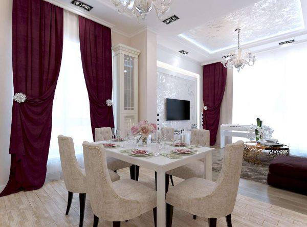 кухня-гостиная с бордовыми шторами и обеденным столом