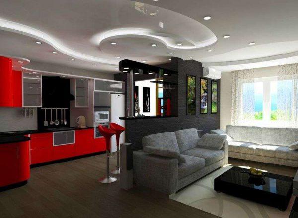 кухня-гостиная с декоративной перегородкой и красным фасадом