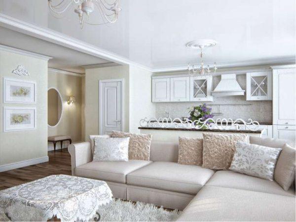 кухня-гостиная с угловым диваном в светлых тонах