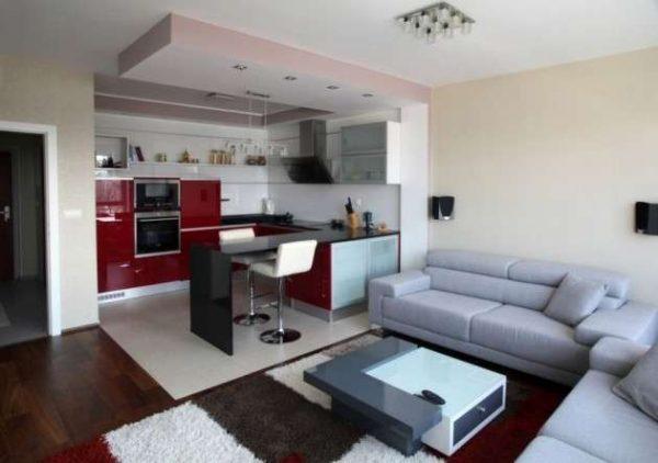 барная стойка отлично зонирует пространство квартиры студии