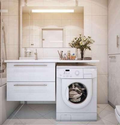 интерьер ванной комнаты с о стиральной машиной под раковиной и туалетом