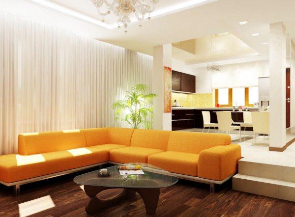 угловой диван в интерьере кухни совмещённой с гостиной