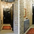 interior-lovely-design-of-an-entrance-hall-with-a-brick-wall-decoration-beige-floor-tile-motif-fitted-red-carpet-and-wall-mirrors-swi