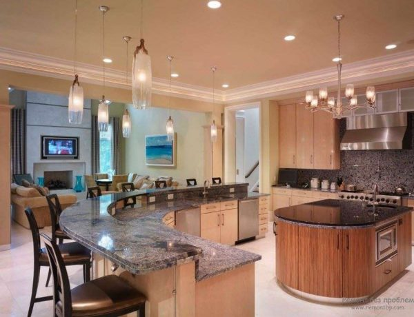 двухуровневая барная стойка в интерьере гостиной кухни