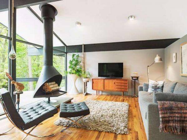 камин в интерьере гостиной в стиле модерн