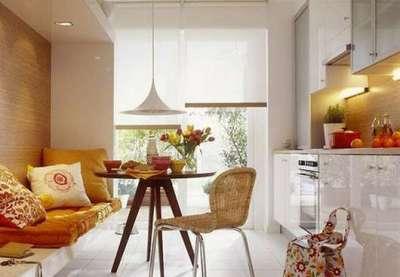 стильный диван с подушками в интерьере кухни гостиной 13 кв. м