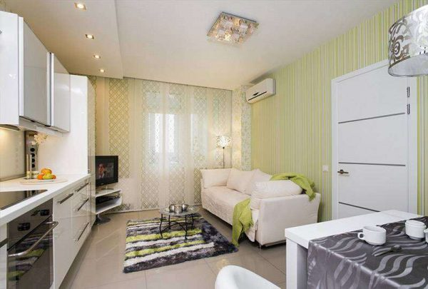 светлая мебель в интерьере кухни гостиной 14 кв. м.