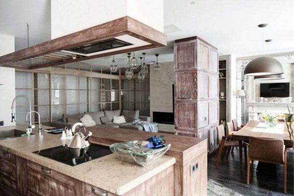 островная зона с мощной вытяжкой в интерьере кухни гостиной 17 кв. м