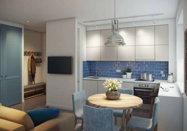круглый обеденный стол в интерьере кухни гостиной 17 кв. м