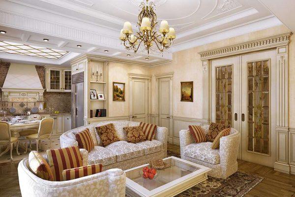 роскошный диван и кресла в гостиной совмещённой с кухней