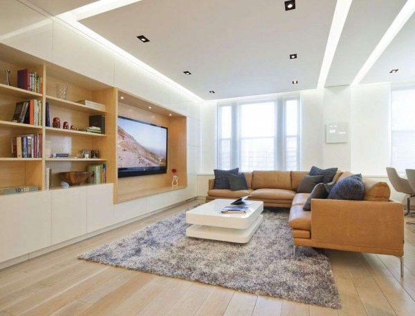 телевизор в интерьере гостиной, встроенный в мебельную стенку
